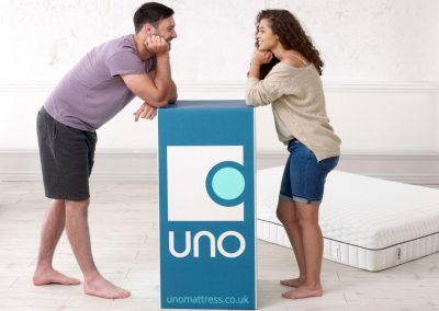 Uno Breathe mattress lifestyle couple with box hi res_3